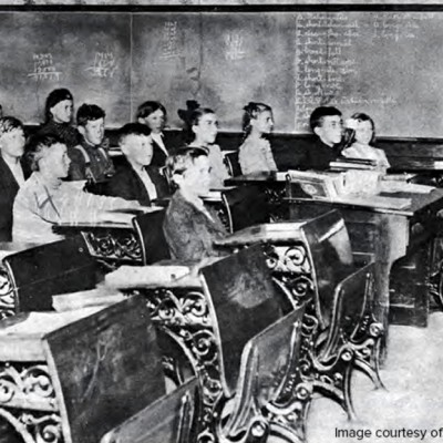 A classroom full of 8th graders in 1906.