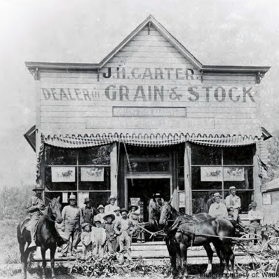 The J.H. Carter Store, located on the North side of the Waukee Triangle, sold grain and livestock.