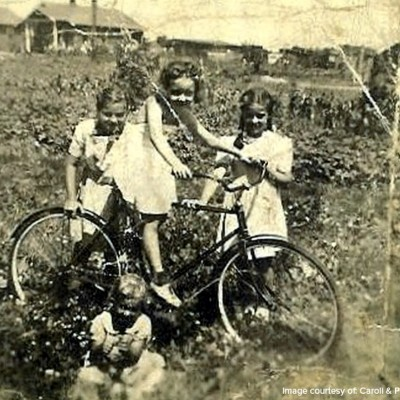 A few families had bikes, which provided endless hours of entertainment, and a way for people to get to the stores, work, and to friends' houses in the other camps. Kids also played tag, hopscotch and jumped rope.