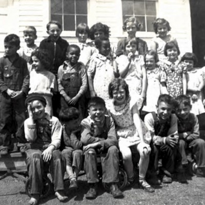 This photo is of students in front of the Waukee Mine School, taken around 1935. It's interesting to see the diversity of students during that time.